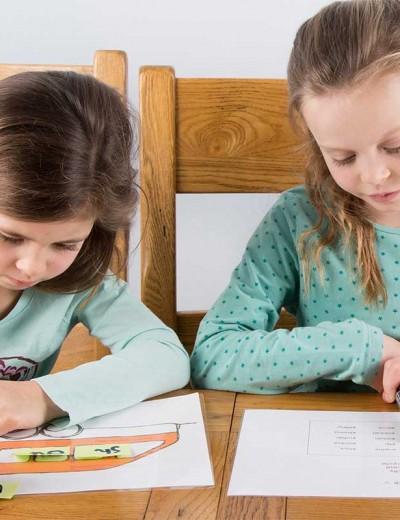 Maggie Tanner children working on tasksheets
